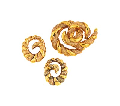 A brooch and pair of earrings
