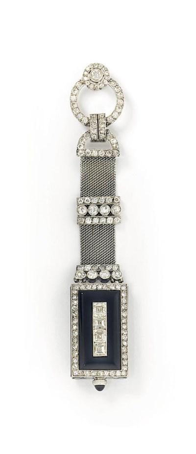 An Art Deco onyx and diamond l