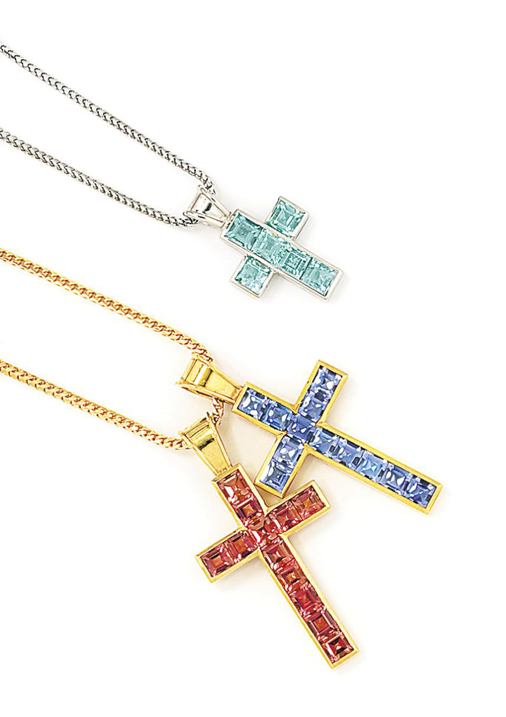 Three gem-set cross pendants, by Theo Fennell