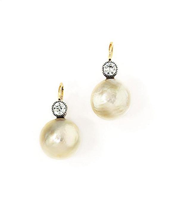 A pair of natural half pearl a