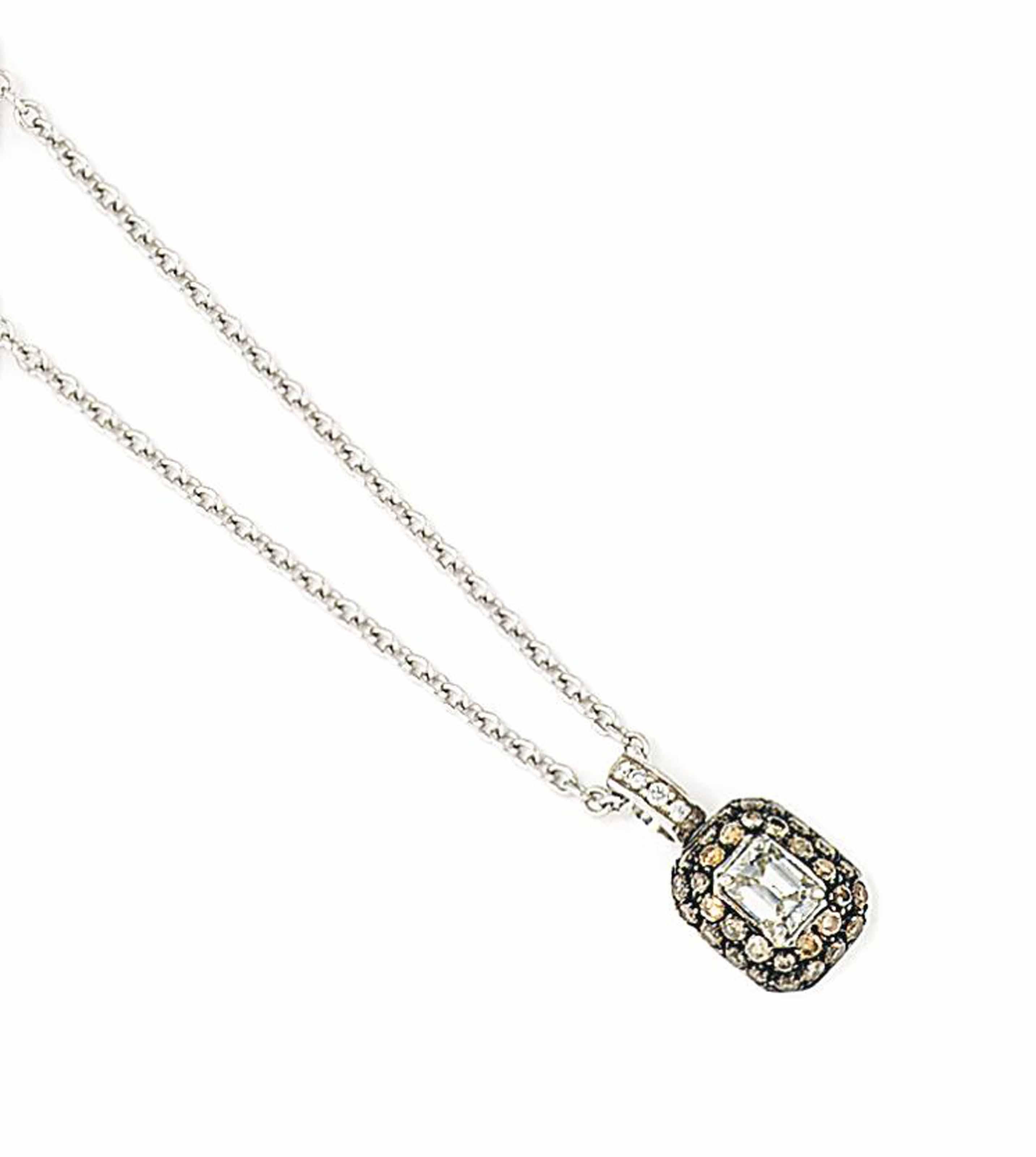 A DIAMOND-SET PENDANT, BY CHAT