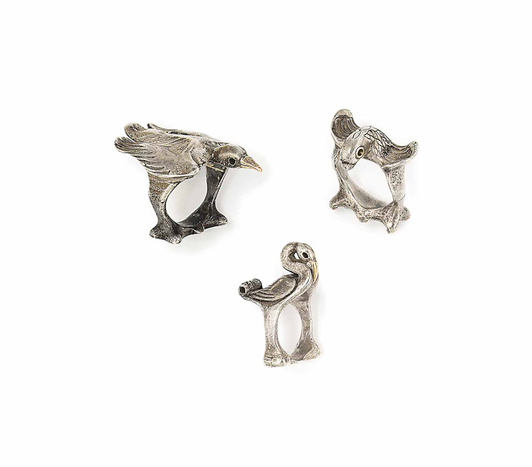 THREE FIGURAL SILVER RINGS, BY