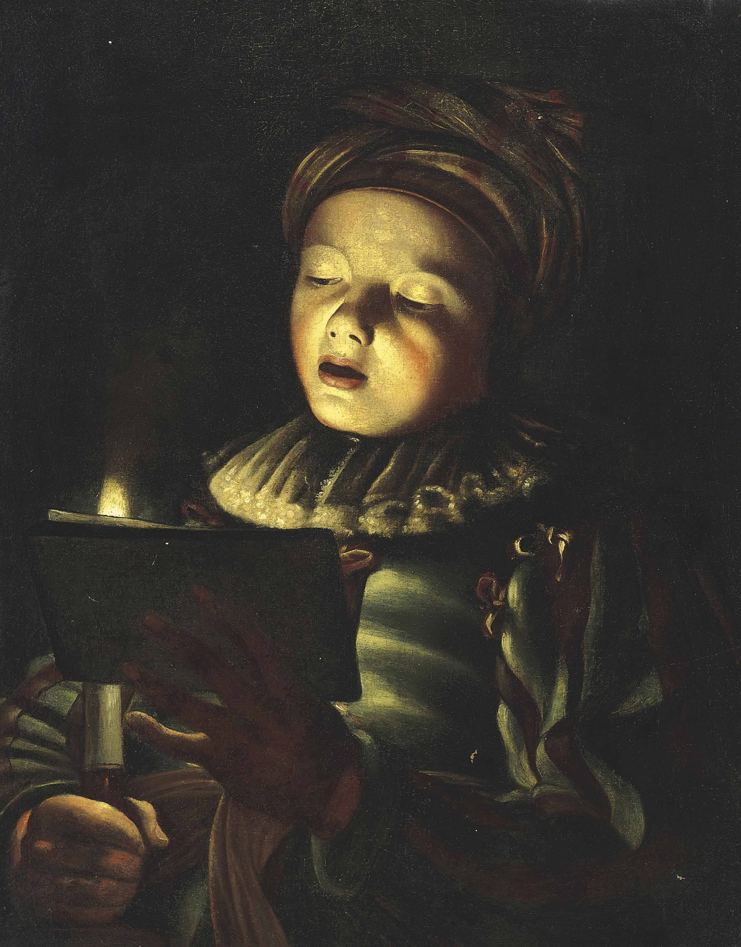 A boy singing by candlelight
