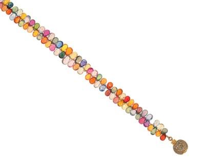 A vari-coloured sapphire and d