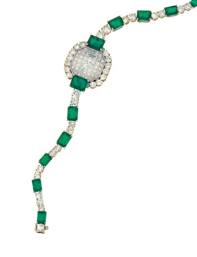 An 18ct white gold, emerald an