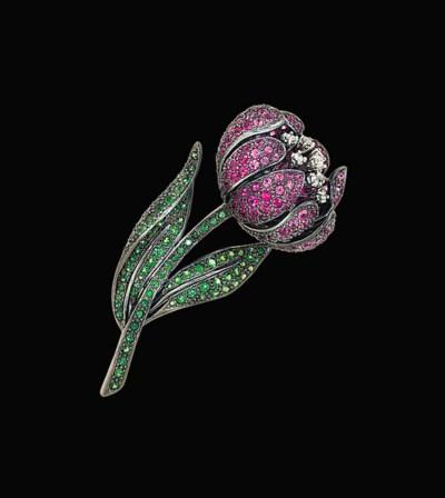 A gem-set flower brooch