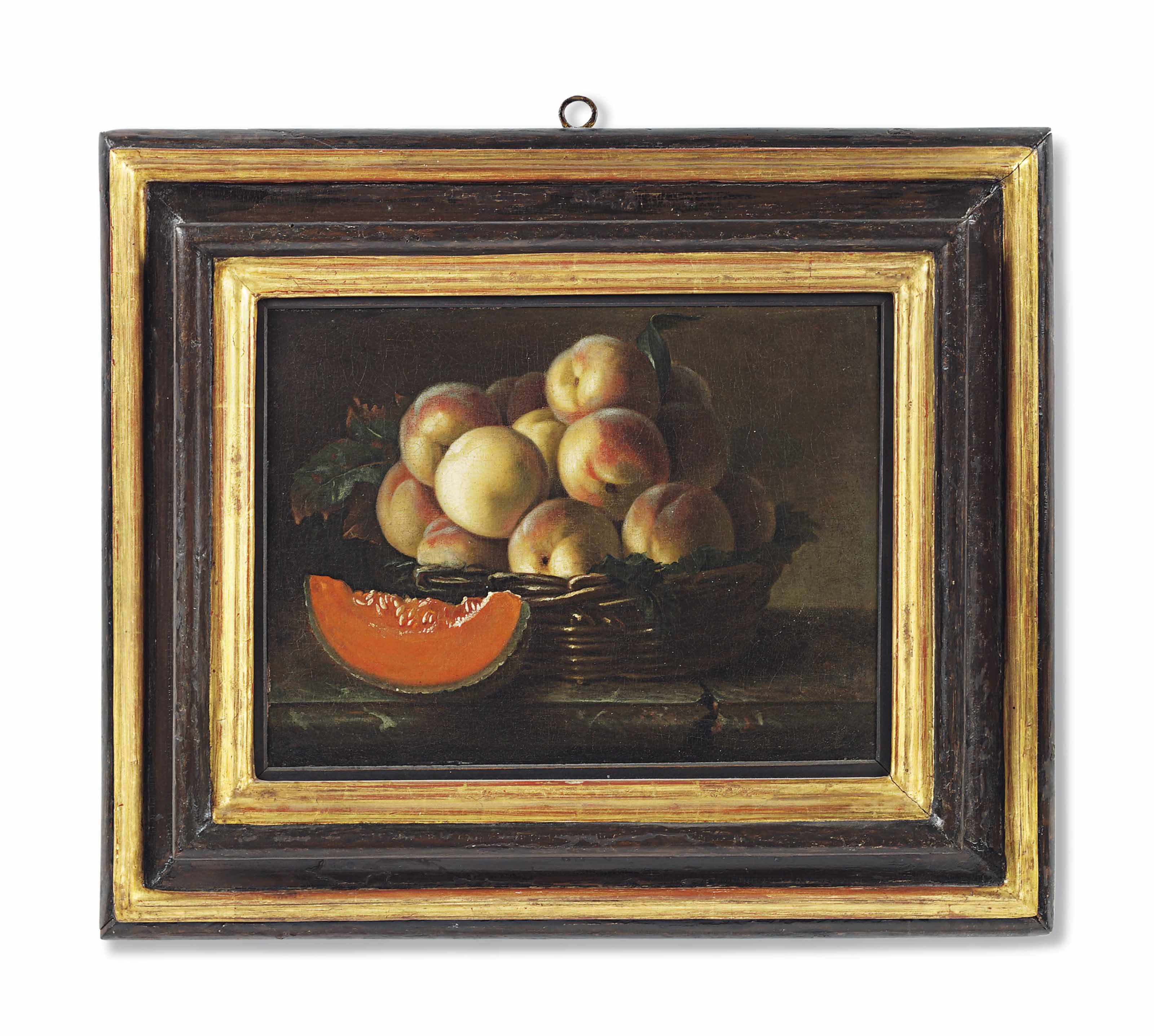 Peaches in a wicker basket with a slice of melon on a ledge