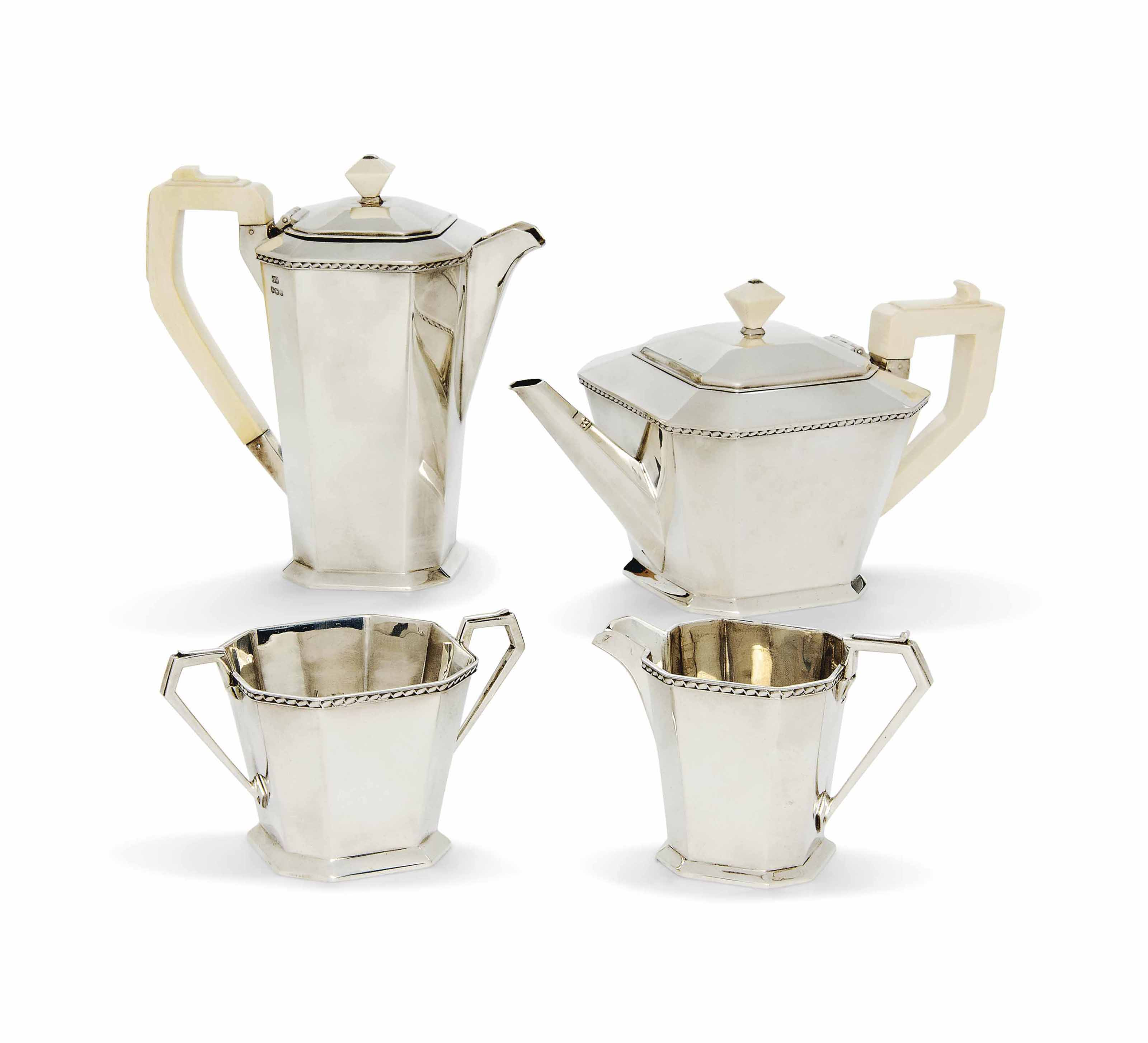 AN ENGLISH SILVER AND IVORY TEA AND COFFEE SET