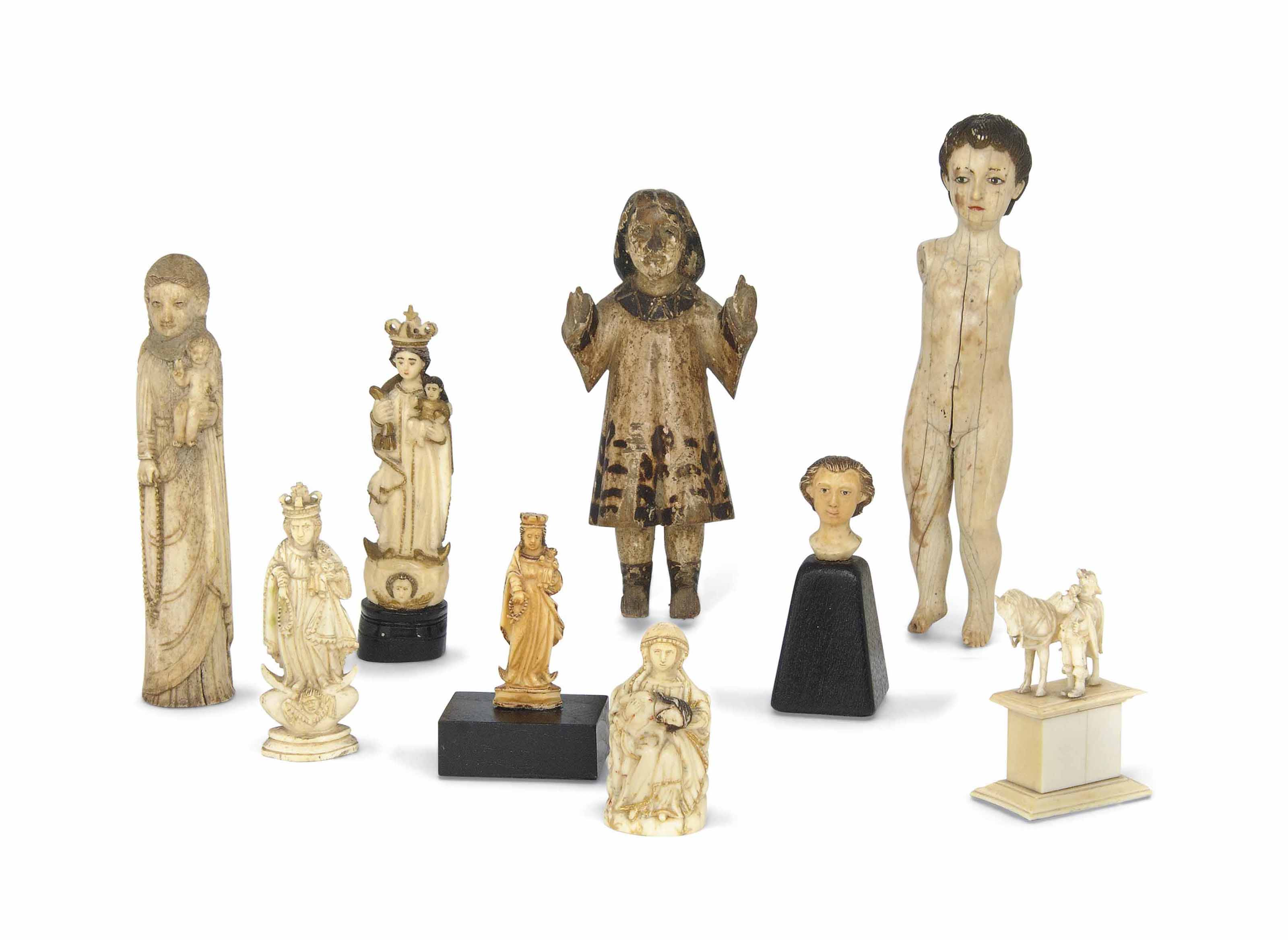 A GROUP OF FIVE HISPANO-PHILIPPINES IVORY FIGURES