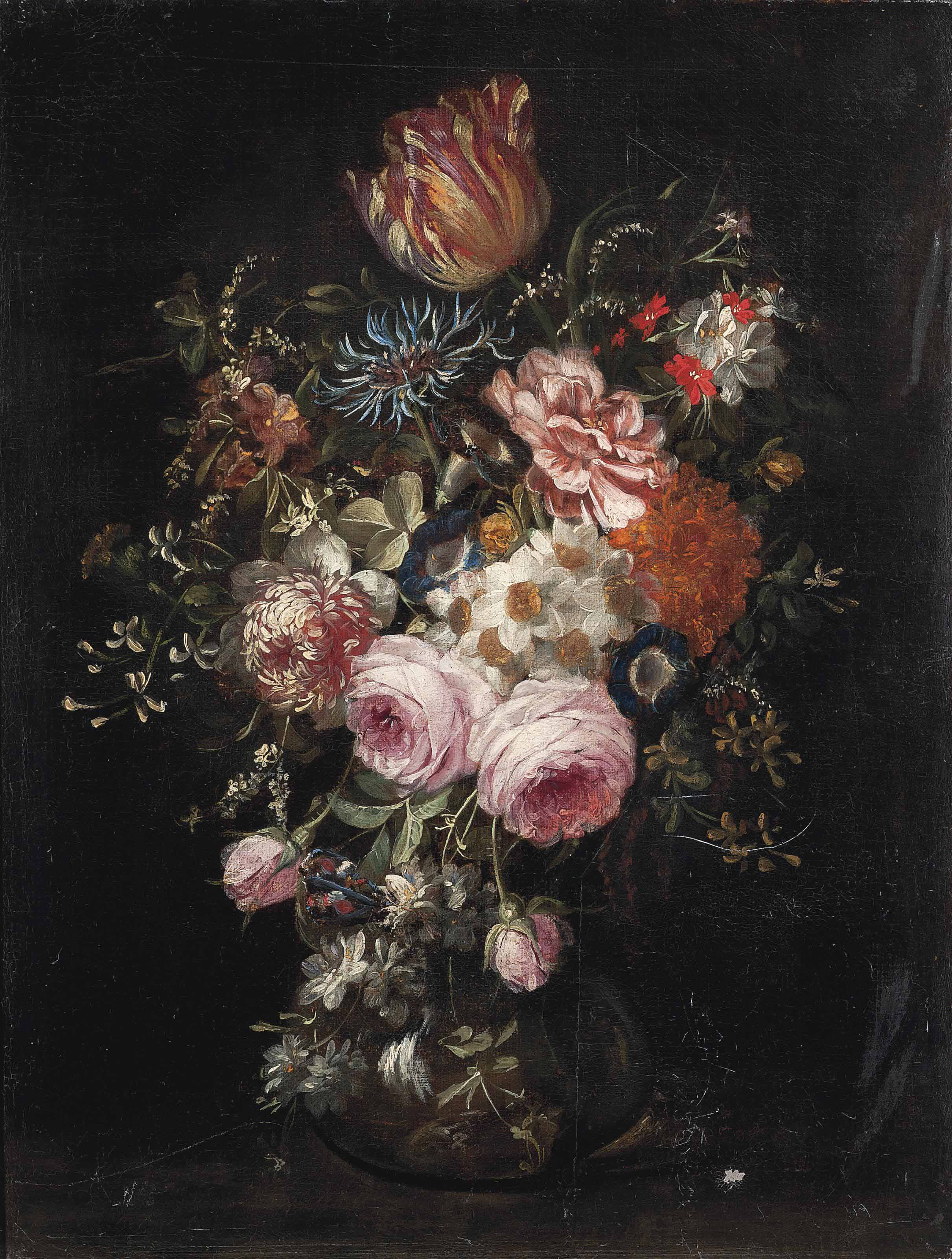 Roses, carnations, lilies, tulips, morning glory and other flowers in a glass vase