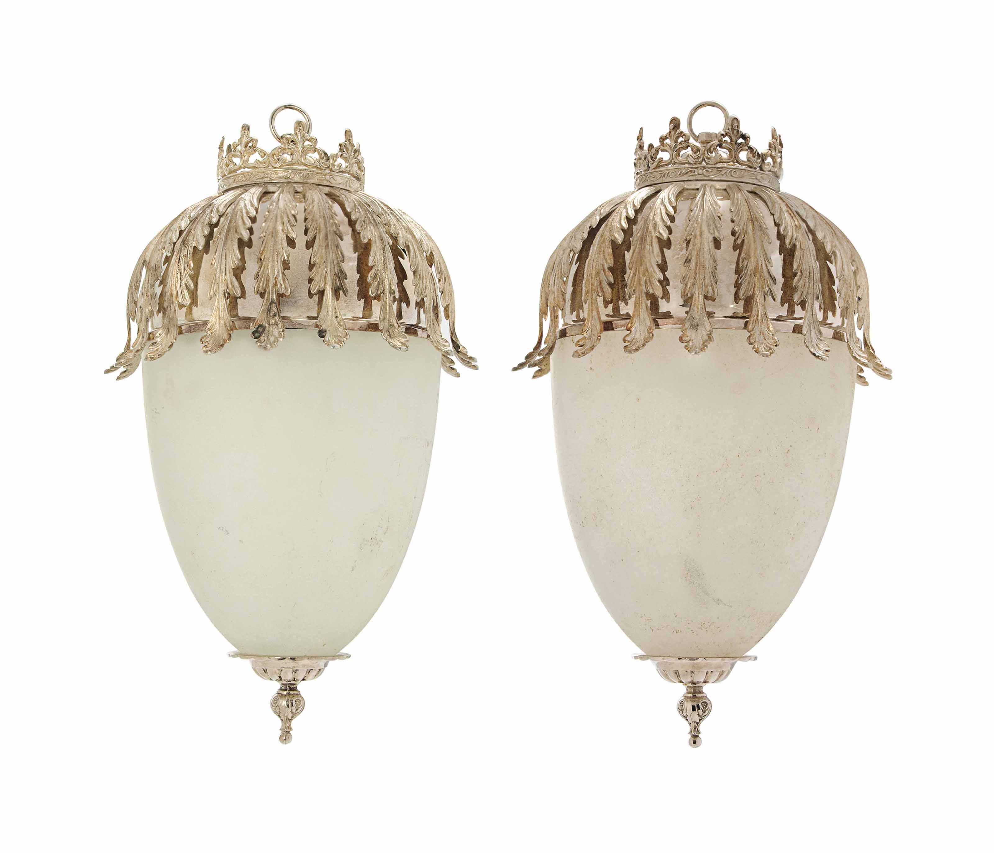 A PAIR OF SILVERED-METAL AND FROSTED GLASS LANTERNS