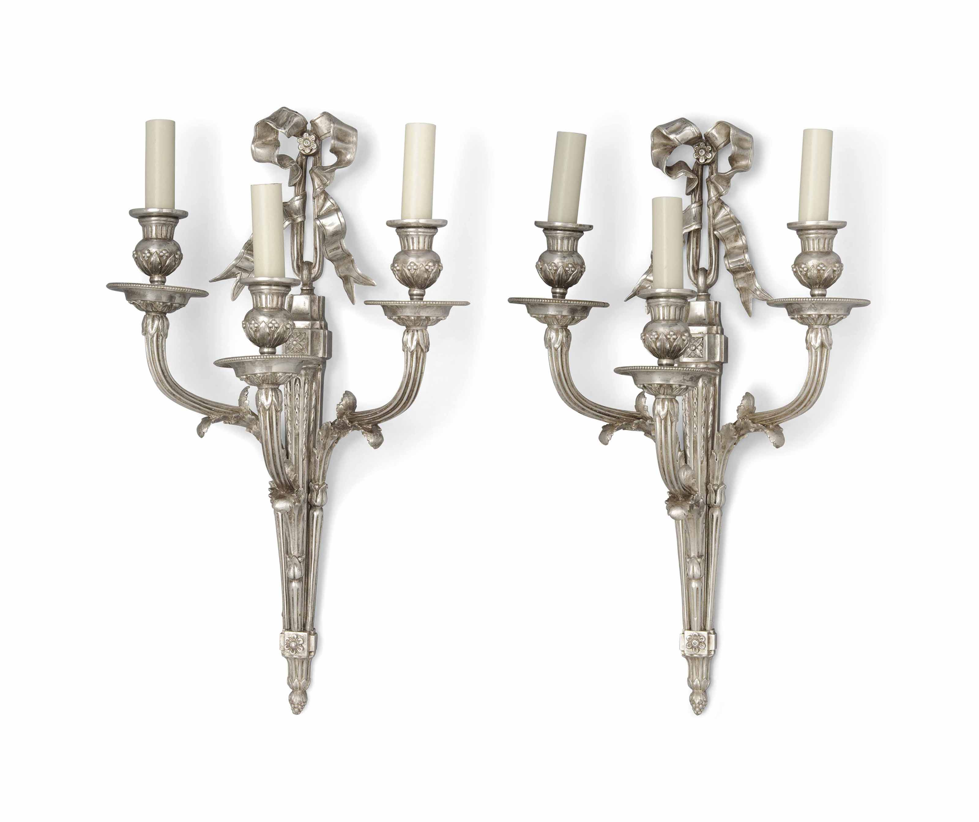 A PAIR OF SILVERED-BRONZE THRE