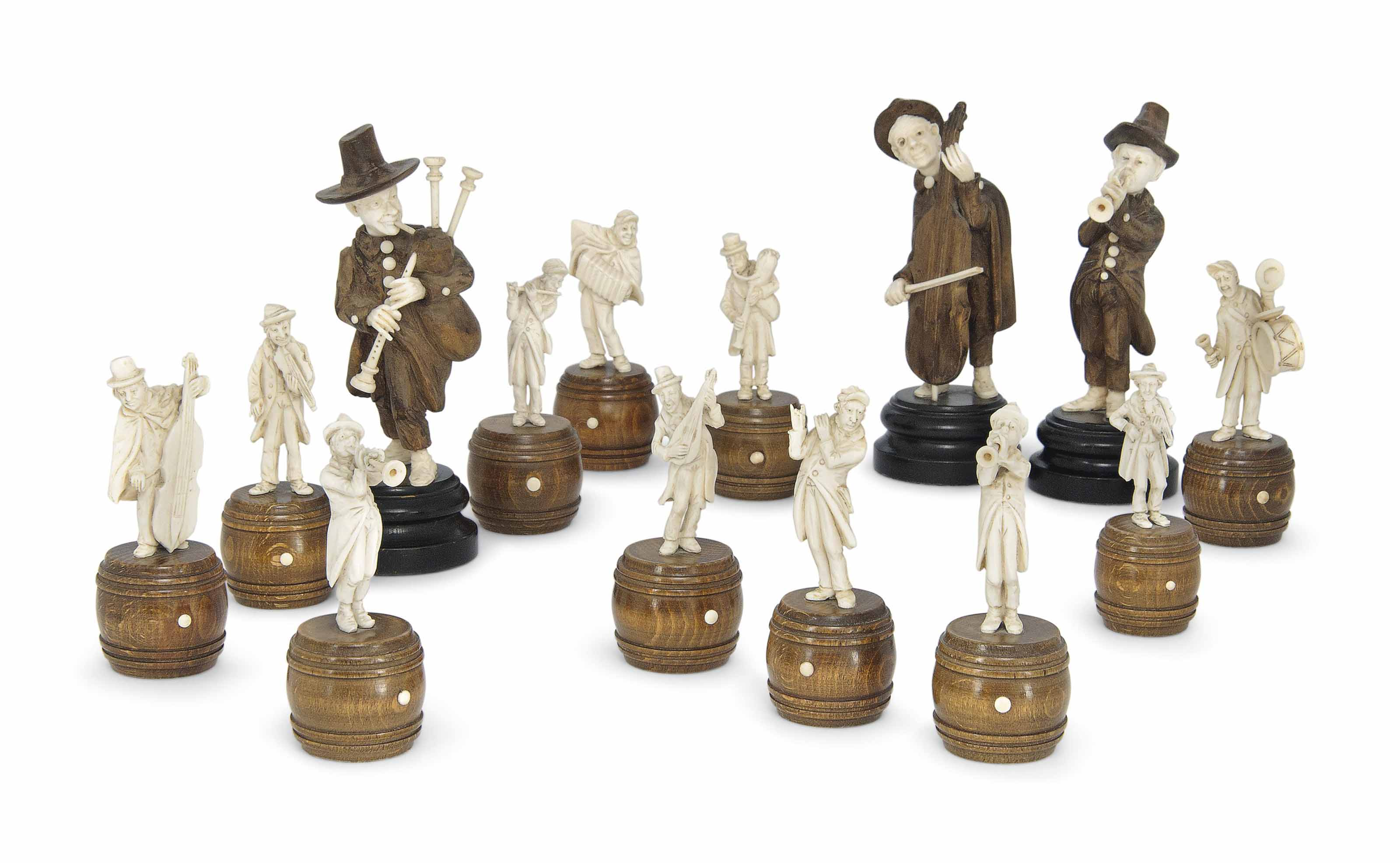 A GROUP OF FOURTEEN GERMAN IVORY AND SOFTWOOD ITINERANT MUSICIANS