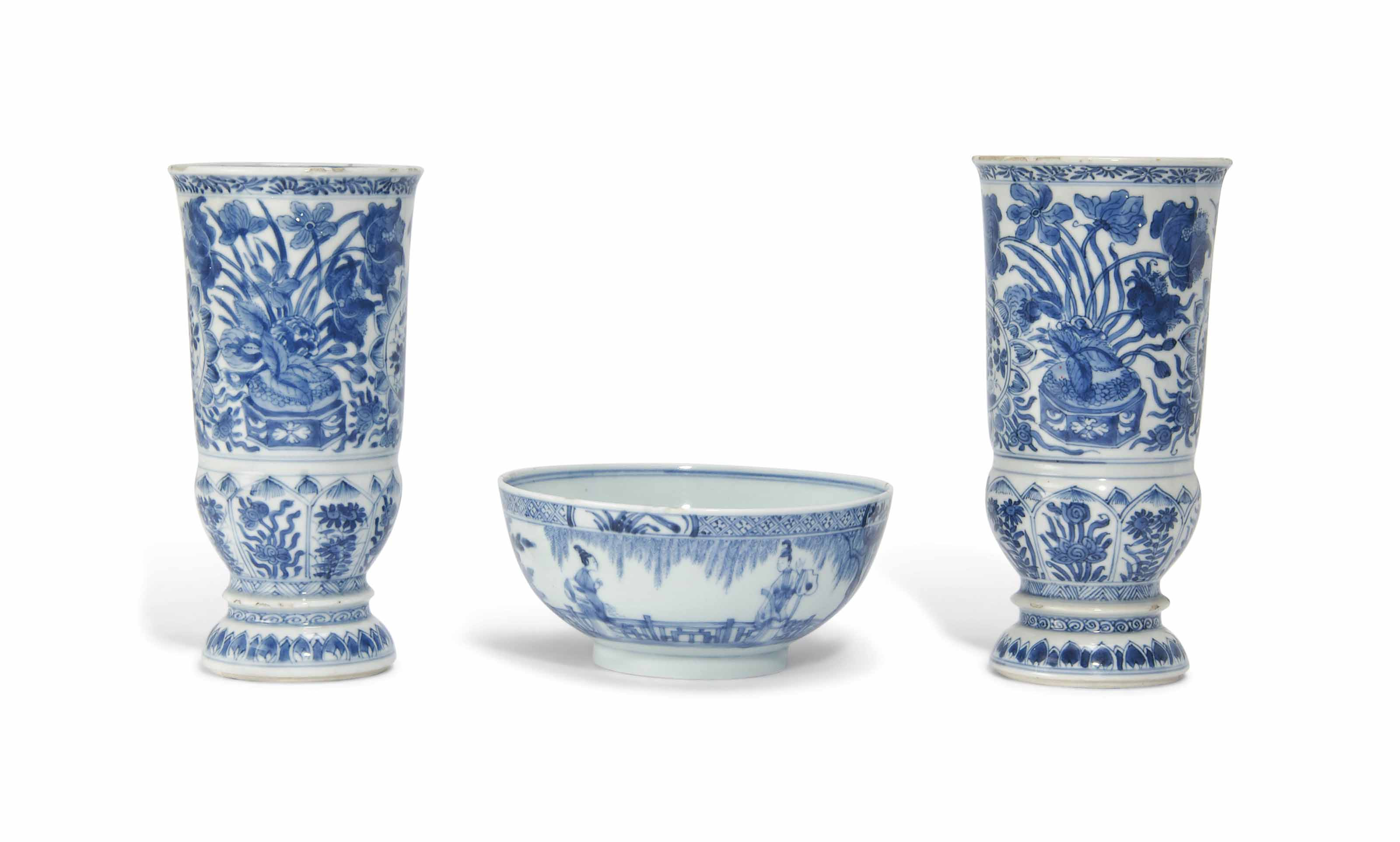 A MATCHED PAIR OF BLUE AND WHITE VASES AND A BLUE AND WHITE BOWL