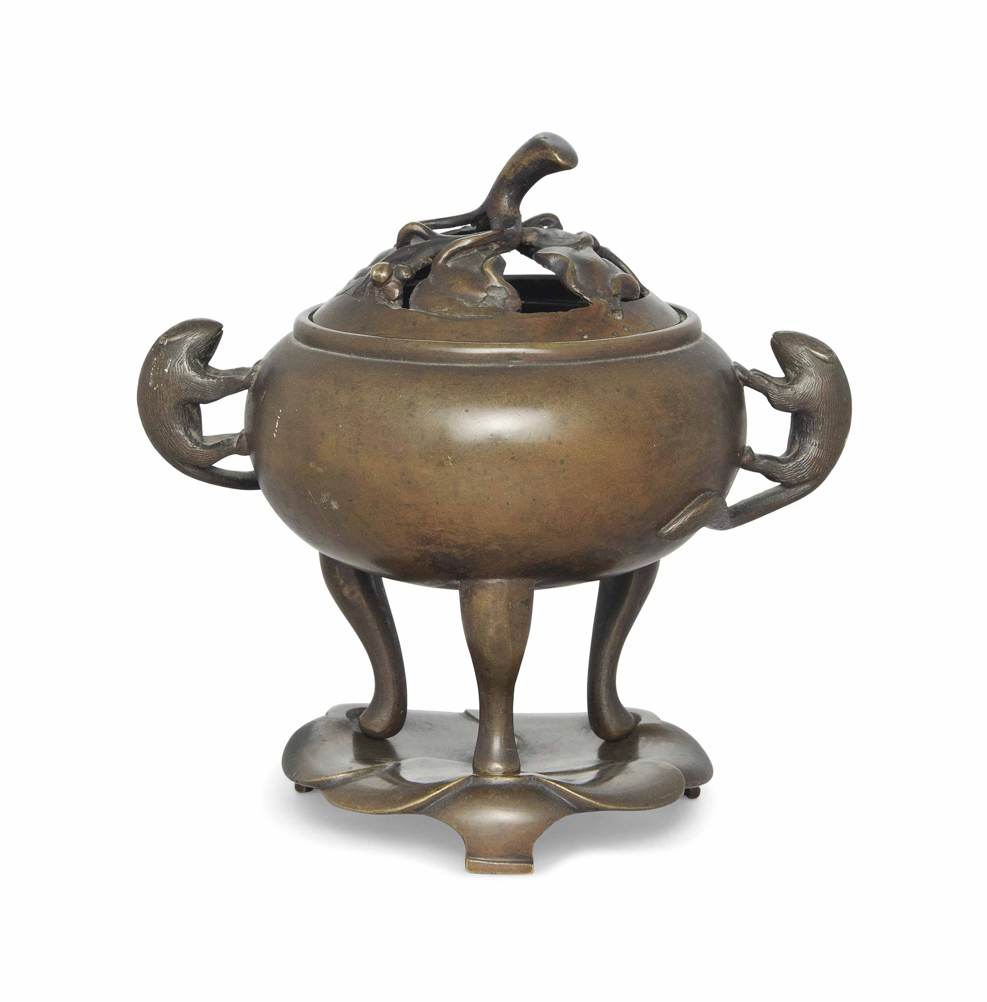 A CHINESE BRONZE 'SHREW AND GR