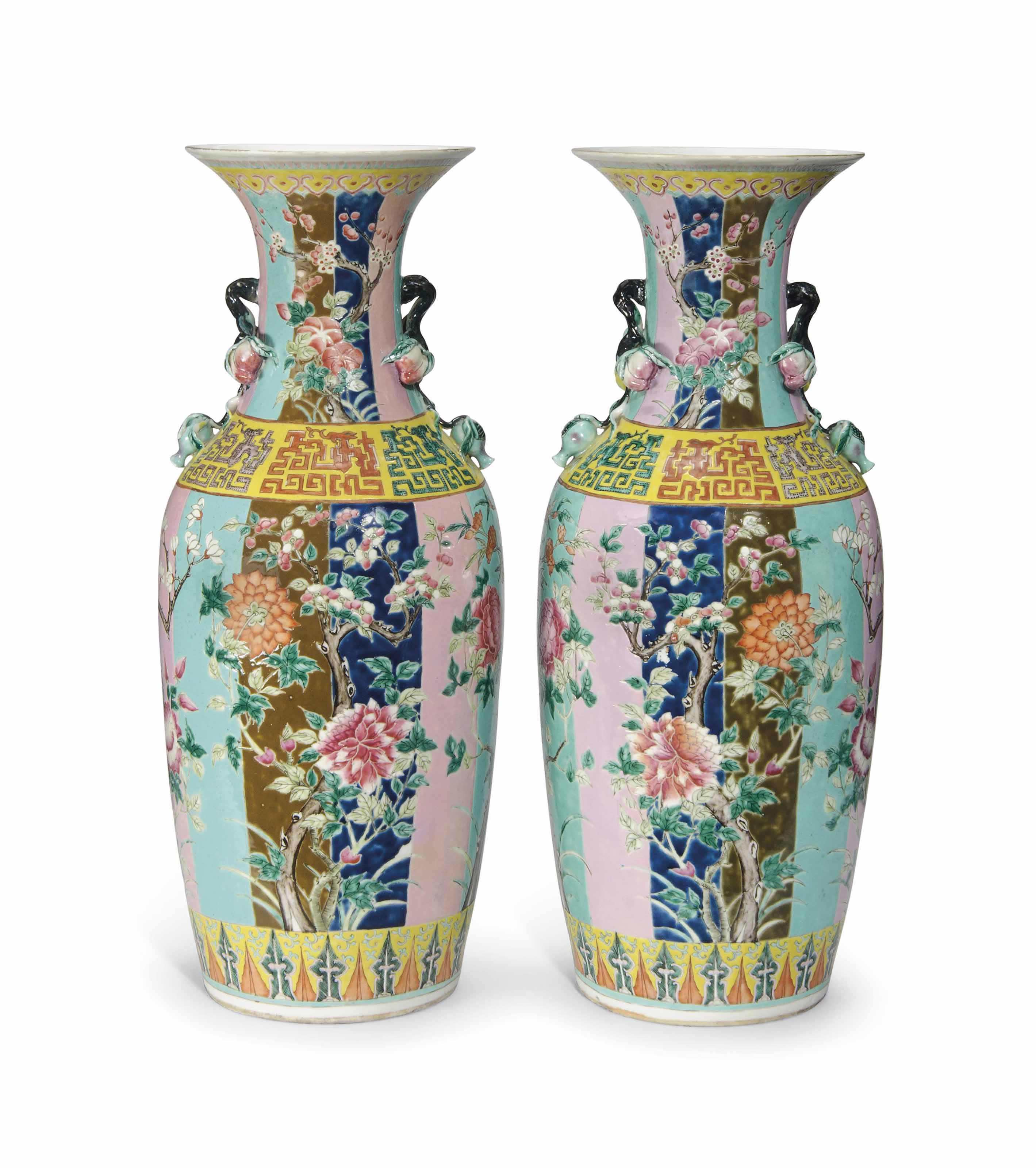 A PAIR OF CHINESE FAMILLE ROSE AND POLYCHROME GROUND VASES