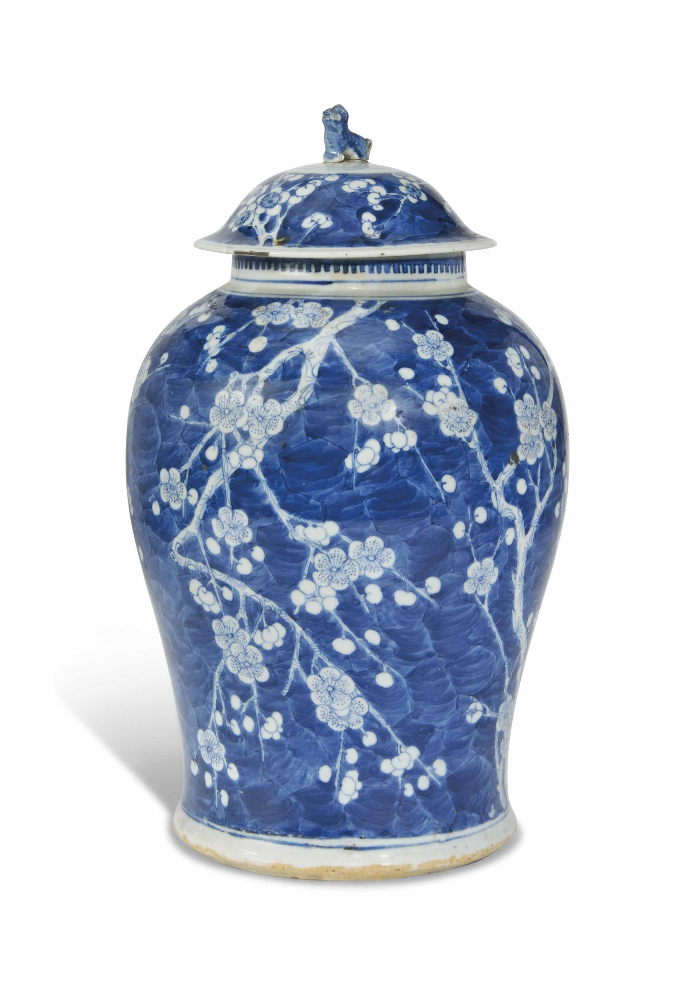 A CHINESE BLUE AND WHITE 'PRUNUS' VASE AND COVER