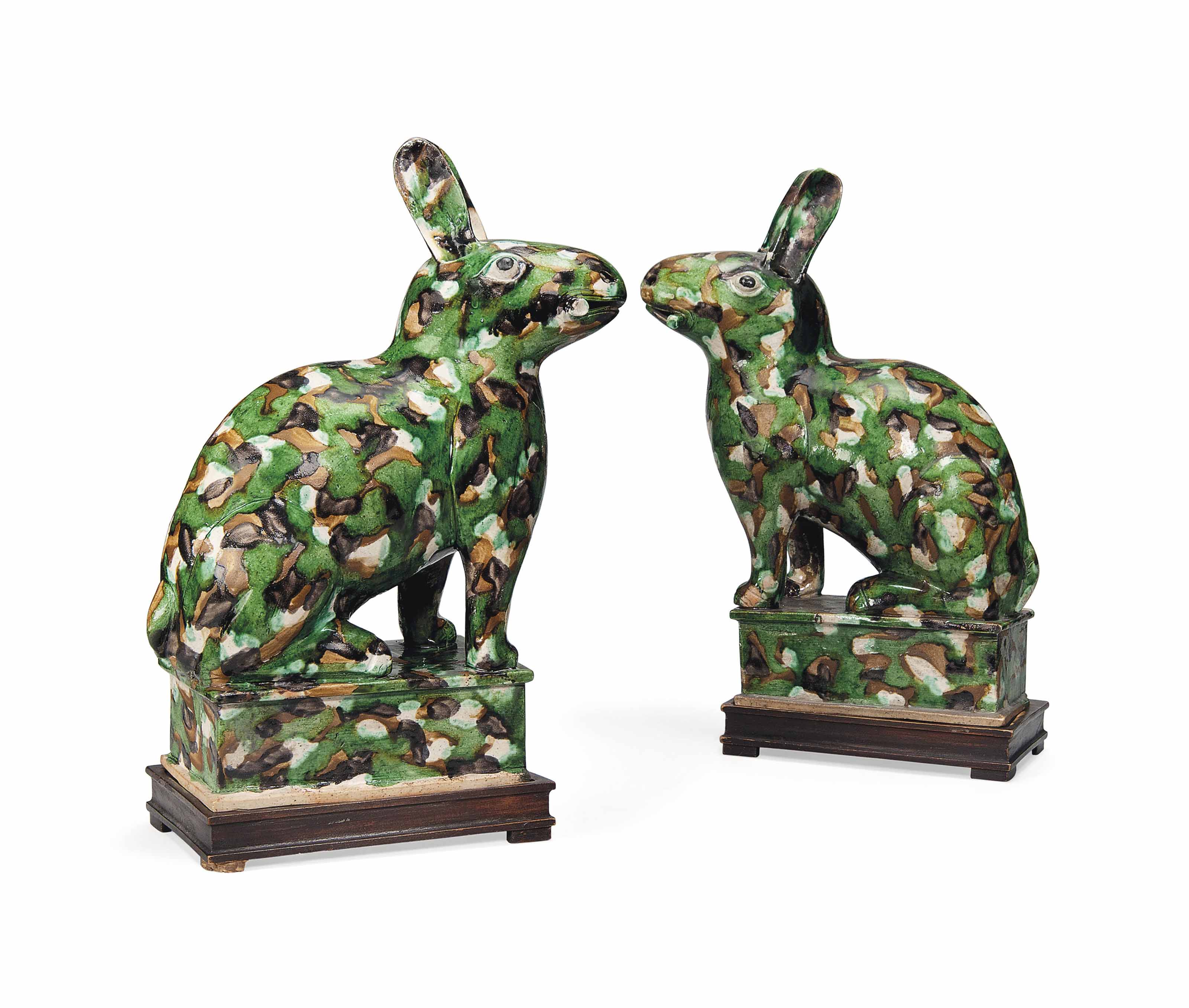 A PAIR OF CHINESE SPINACH, AUBERGINE AND CREAM-GLAZED HARES