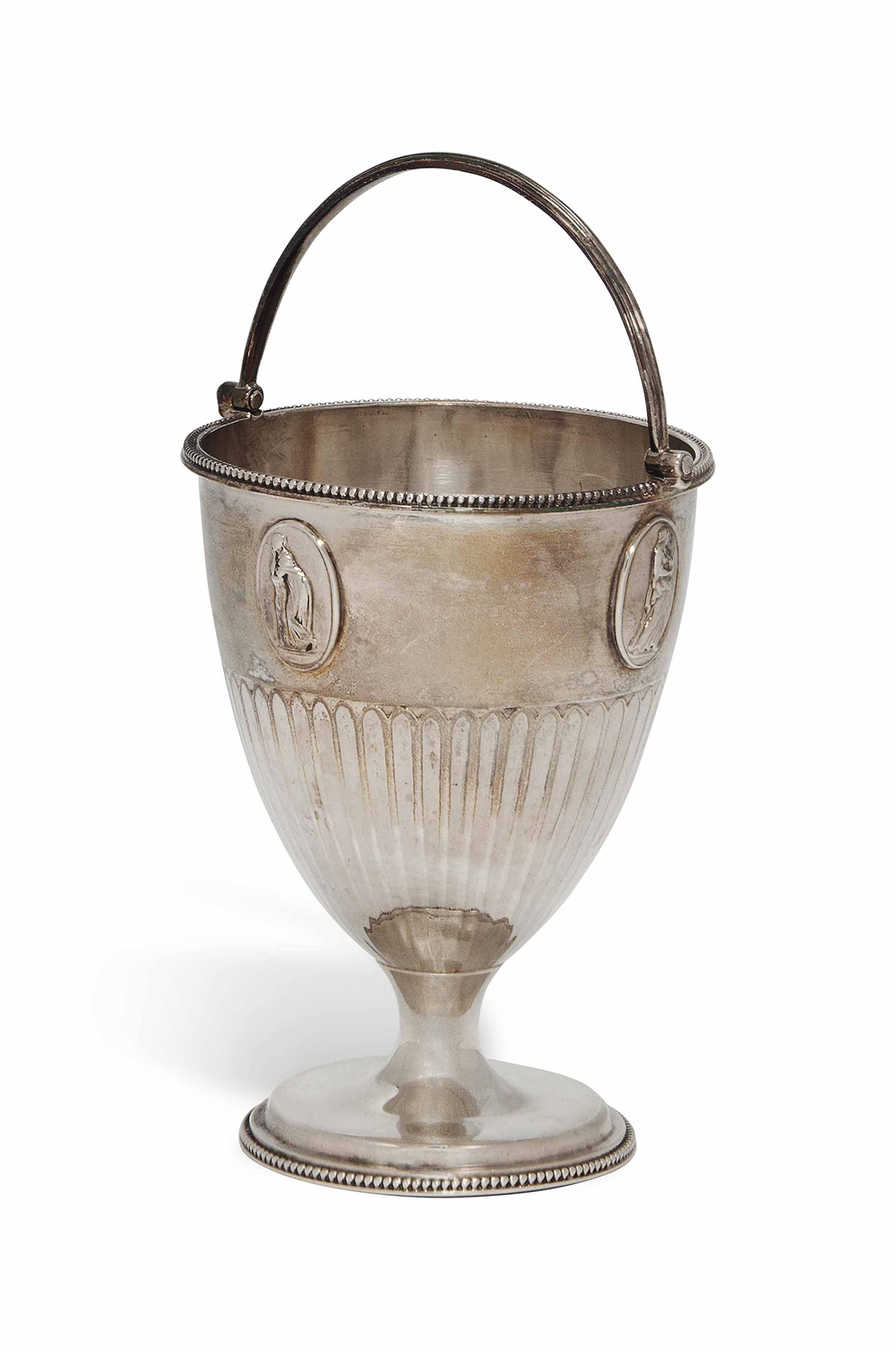 A GEORGE III SILVER SWING-HANDLED SUGAR BASKET
