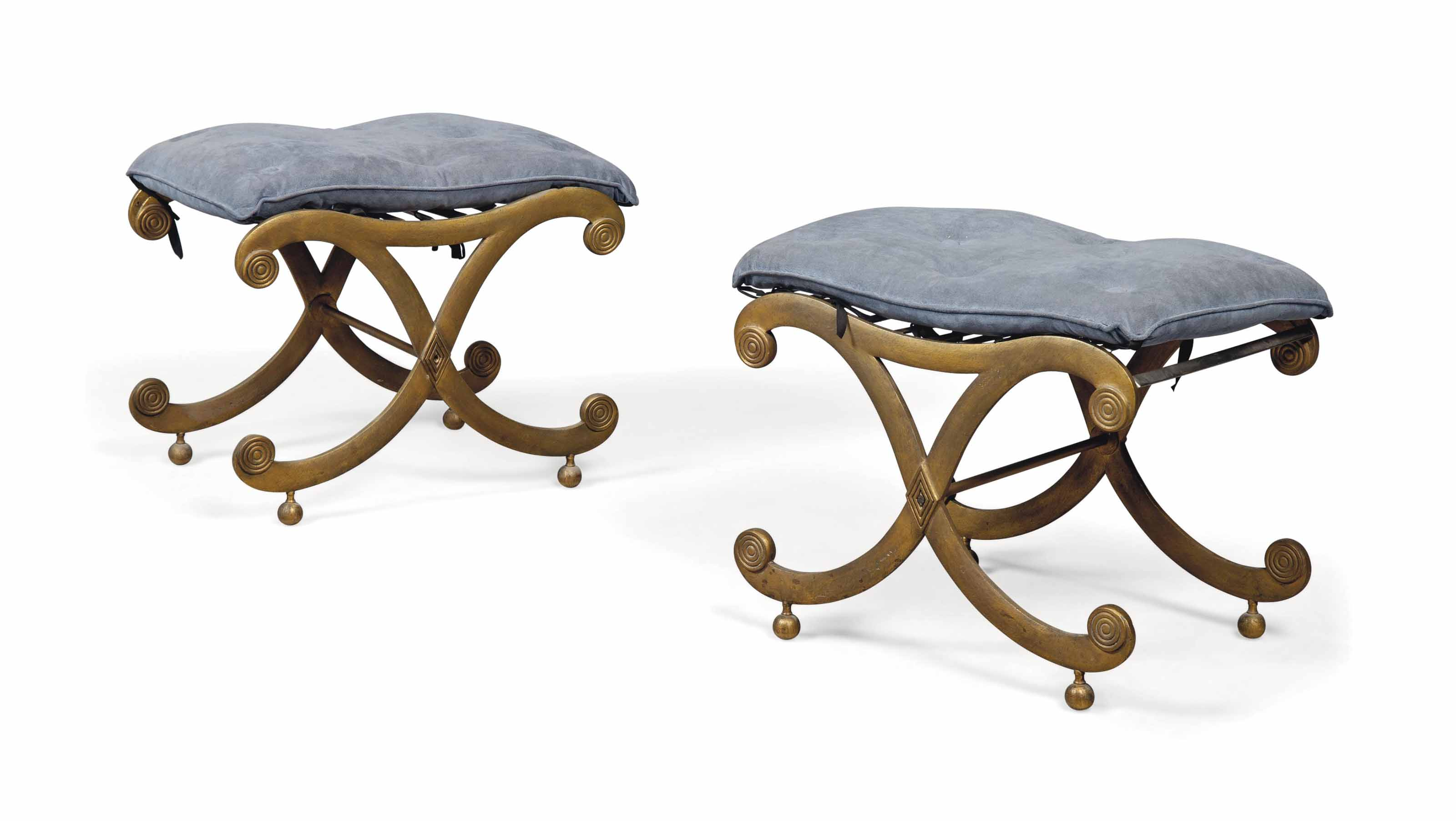 A PAIR OF BRASS STOOLS