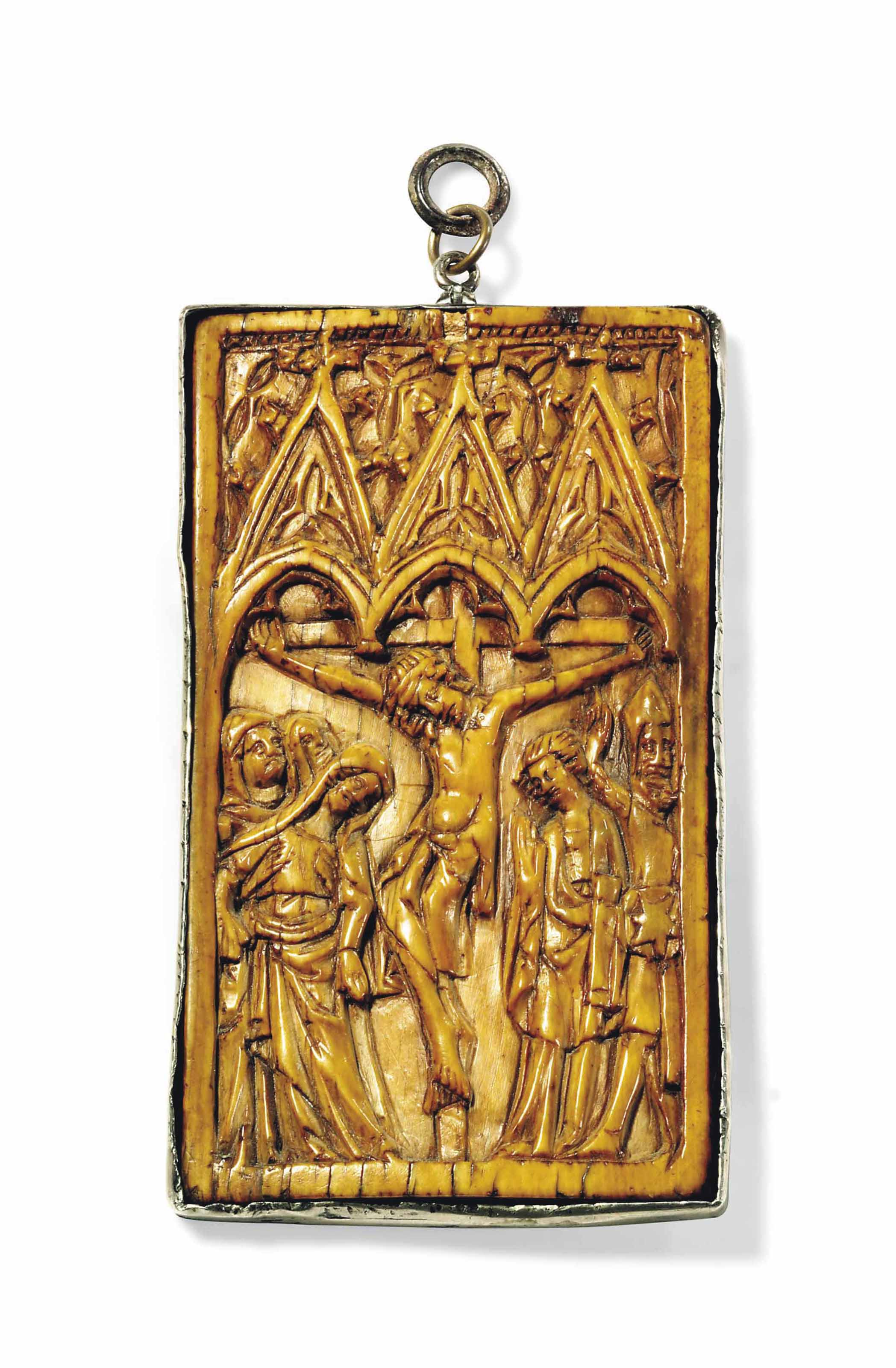 A RECTANGULAR CARVED IVORY RELIEF OF THE CRUCIFIXION