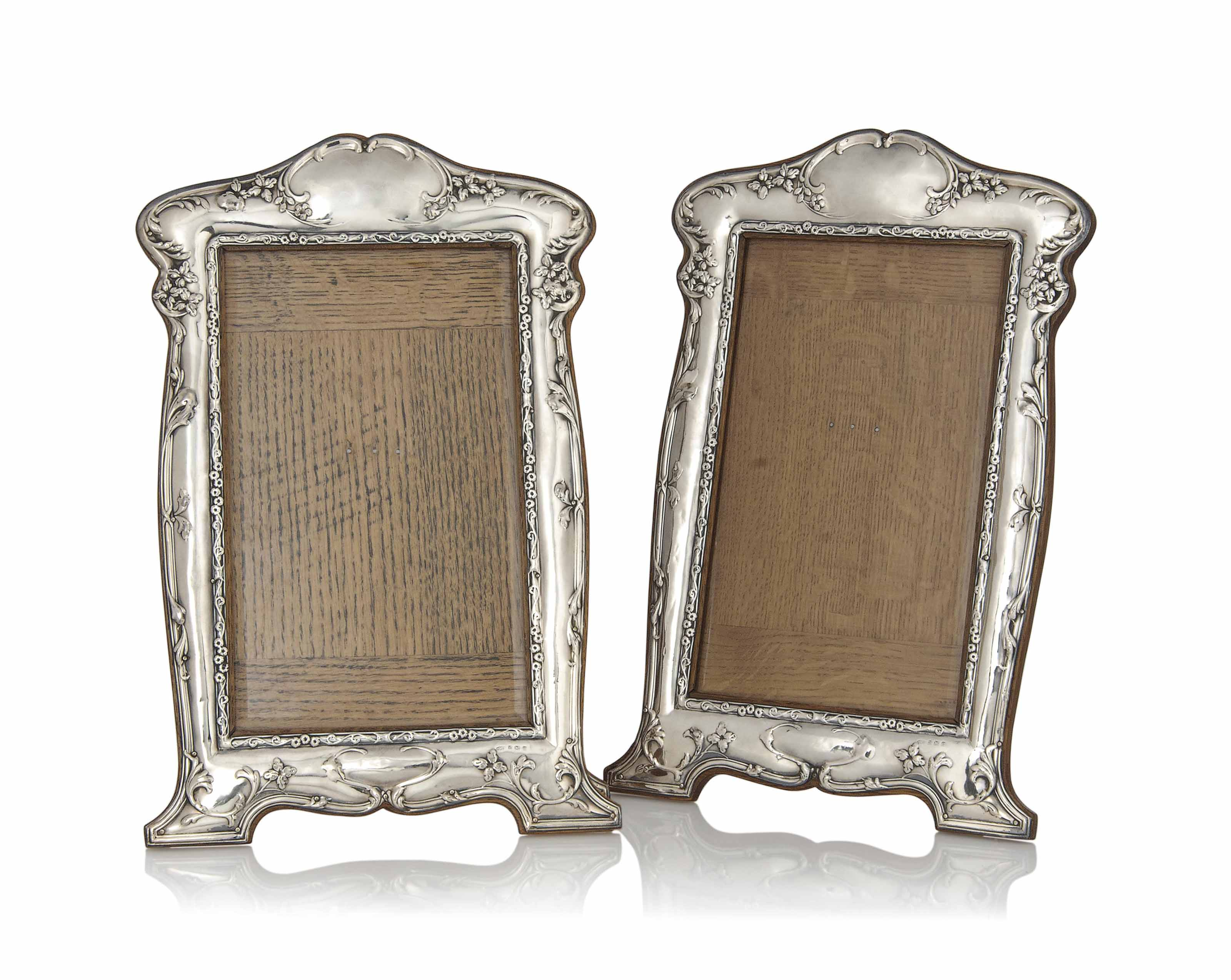 A PAIR OF LARGE SILVER AND OAK PHOTOGRAPH FRAMES