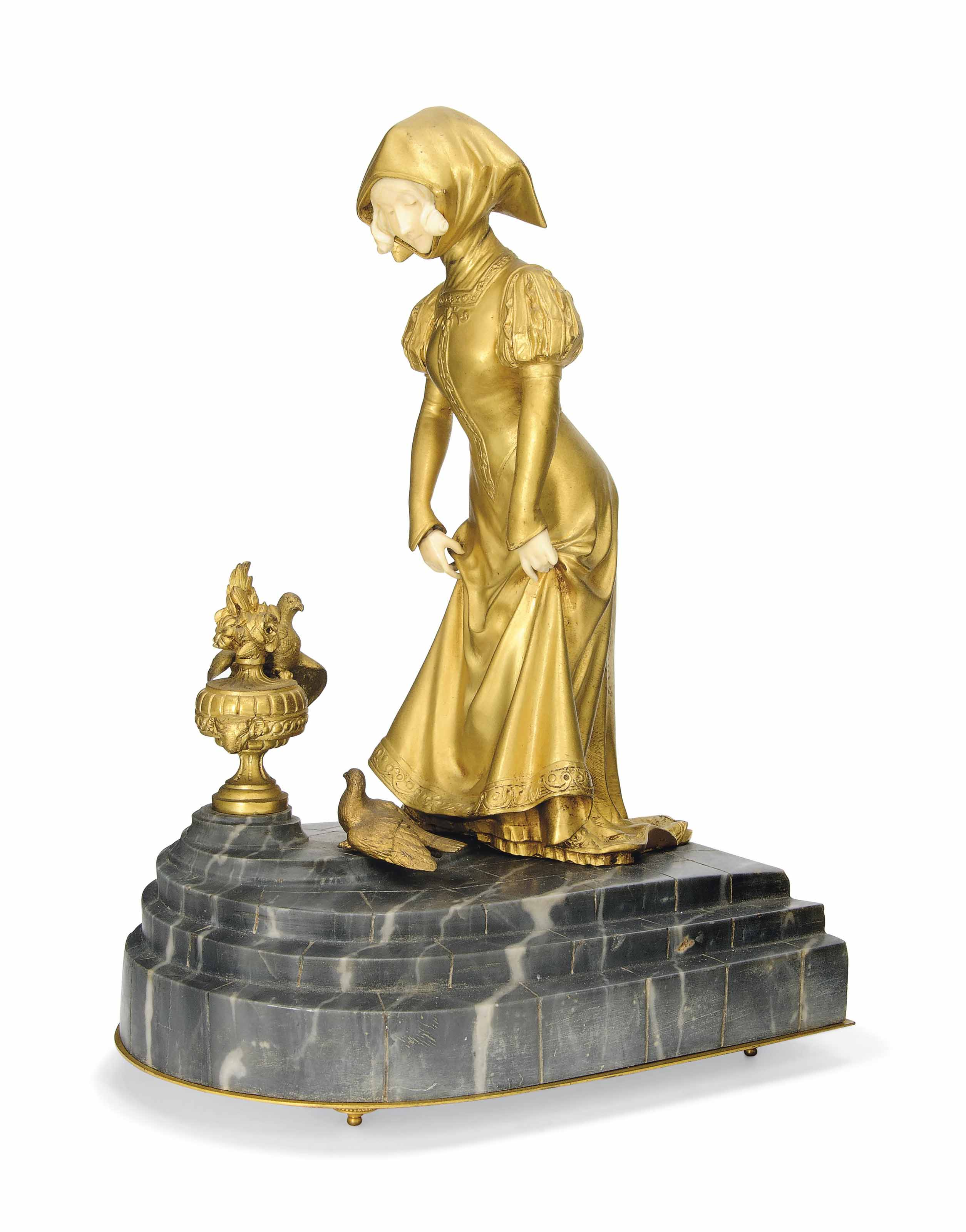 A FRENCH GILT BRONZE AND IVORY