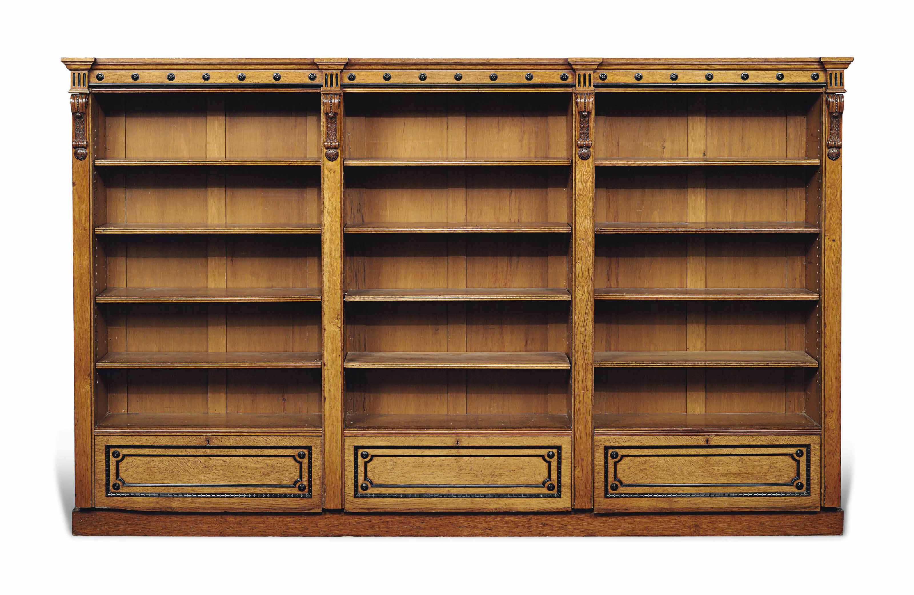 A VICTORIAN OAK AND EBONY OPEN BOOKCASE