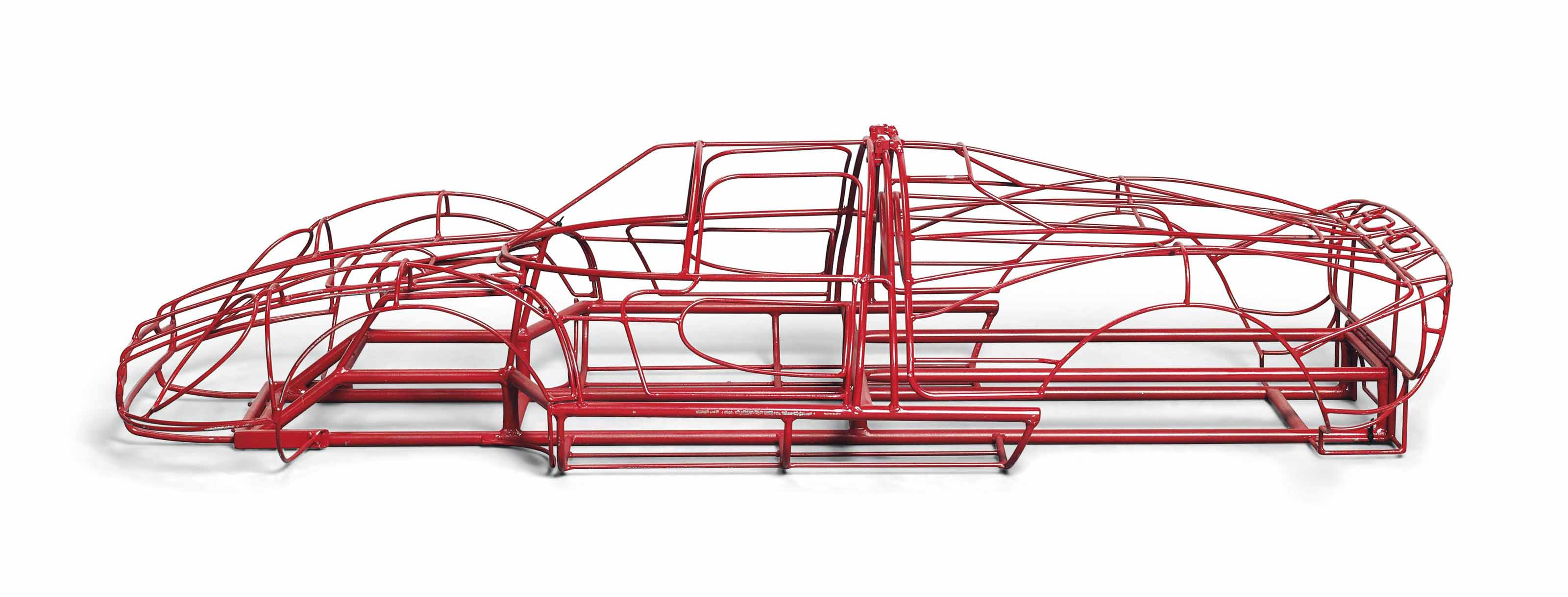 A 1/4 SCALE MODEL OF A RED-PAINTED WIRE BUCK MODEL OF A SPORTS PROTOTYPE