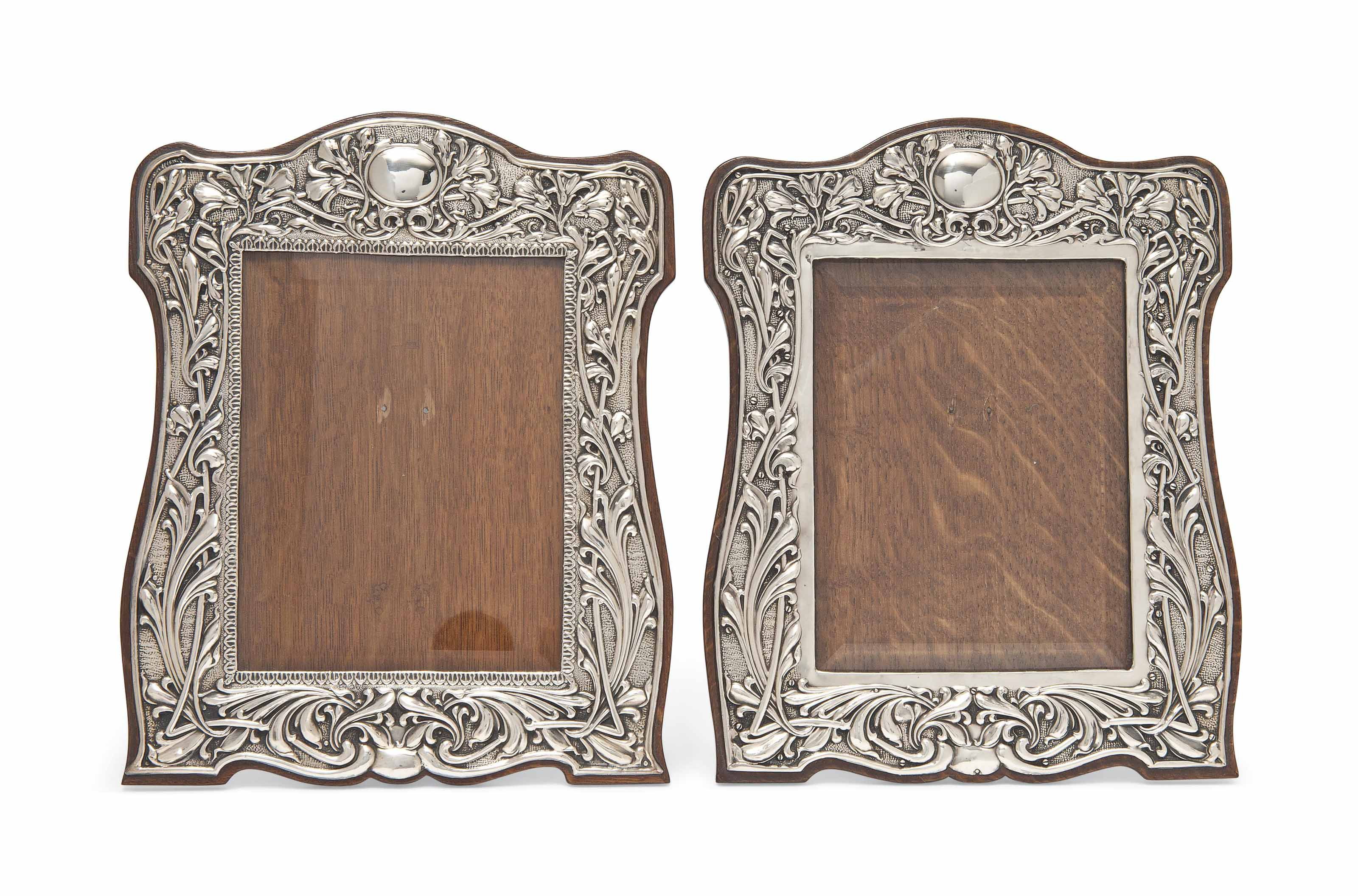 A NEAR PAIR OR EDWARDIAN SILVER AND OAK PHOTOGRAPH FRAMES