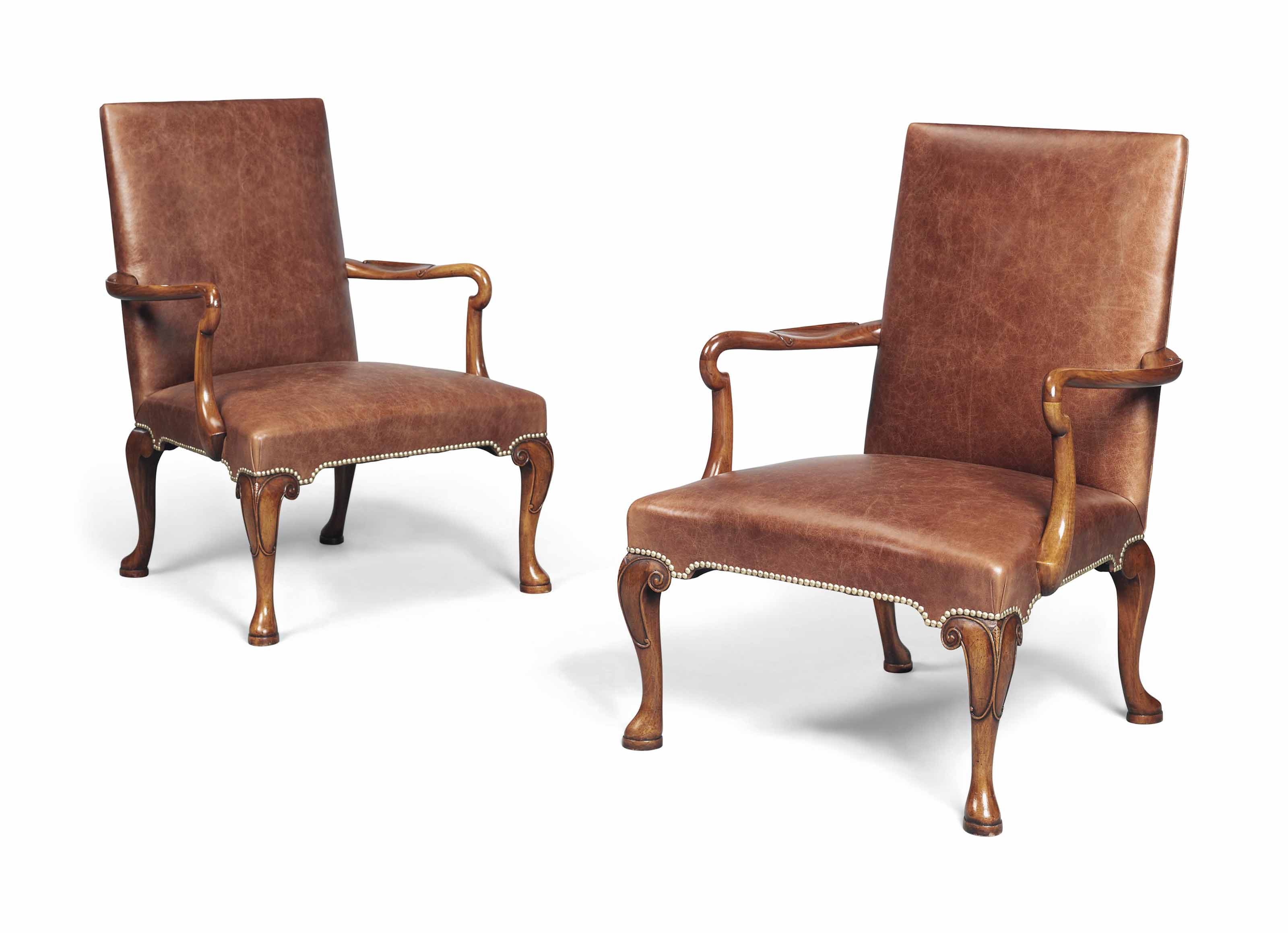 A PAIR OF WALNUT LIBRARY ARMCH