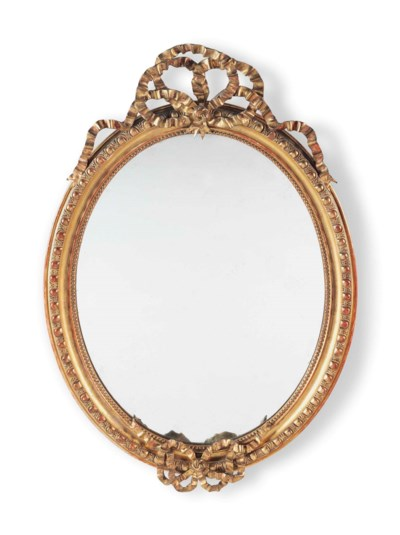 A FRENCH GILTWOOD OVAL MIRROR