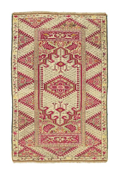An antique Ghiordes rug