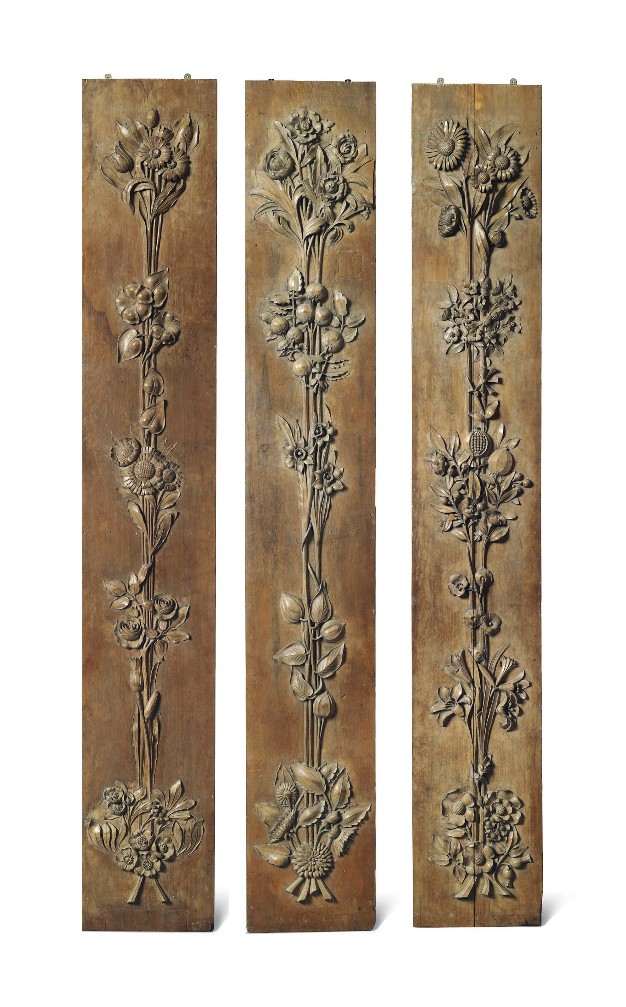 THREE LARGE CARVED PINE PANELS
