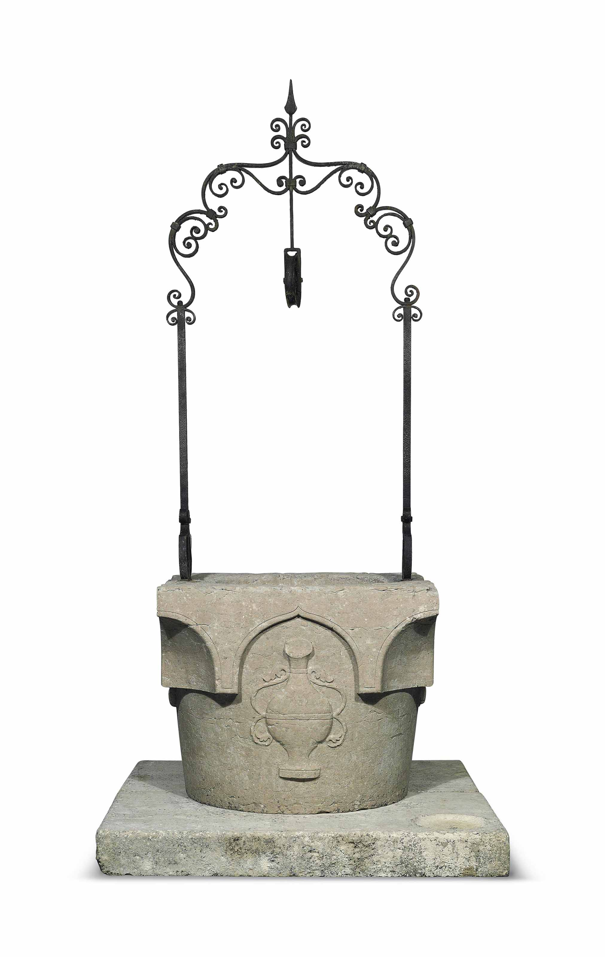 A CARVED ISTRIAN STONE WELL HE
