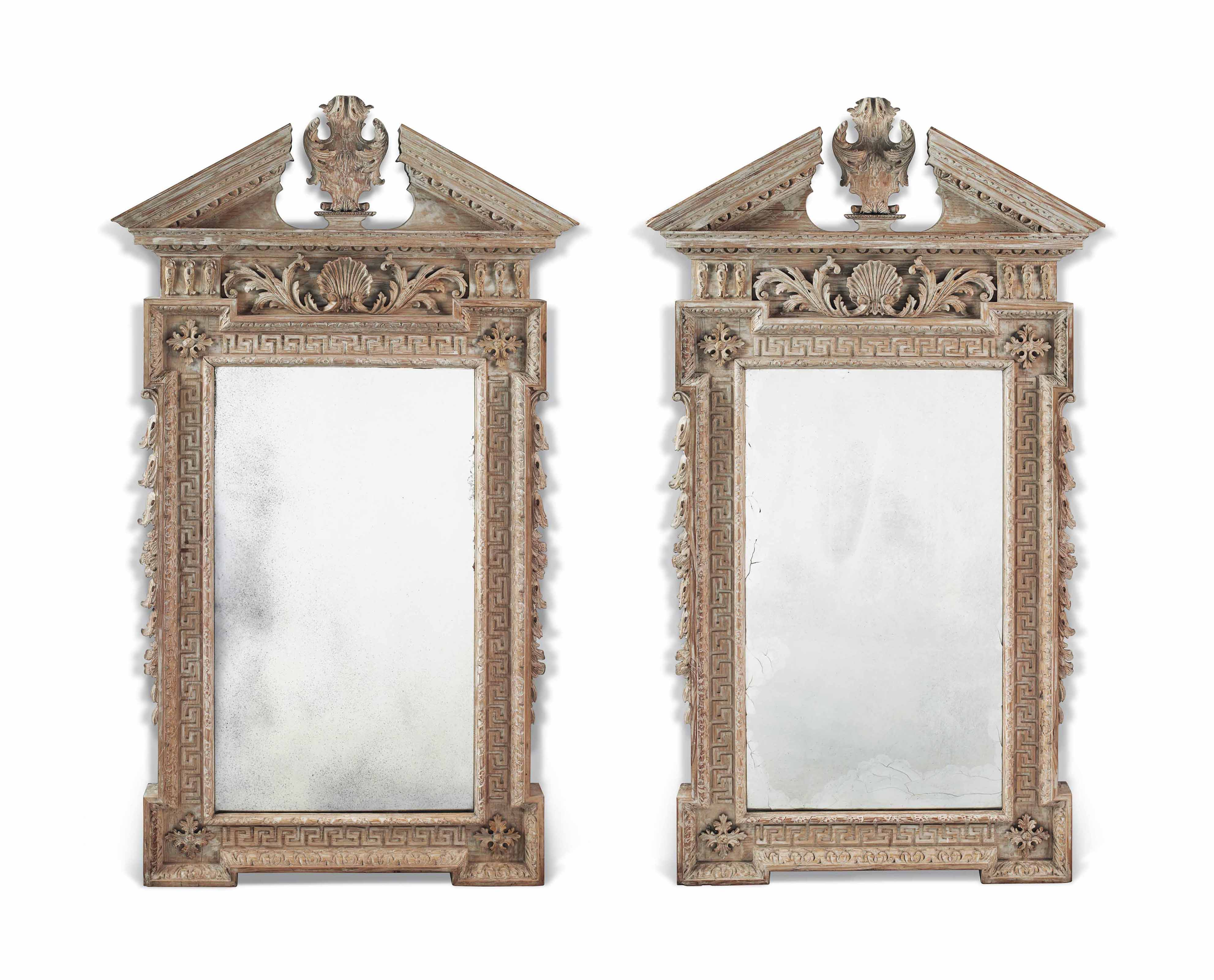 A PAIR OF CARVED PINE MIRRORS