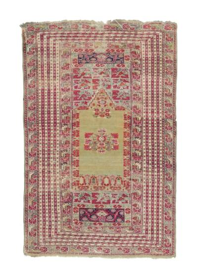 An antique Ghioreds prayer rug