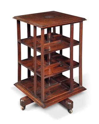 A REVOLVING BOOKCASE MADE OF T
