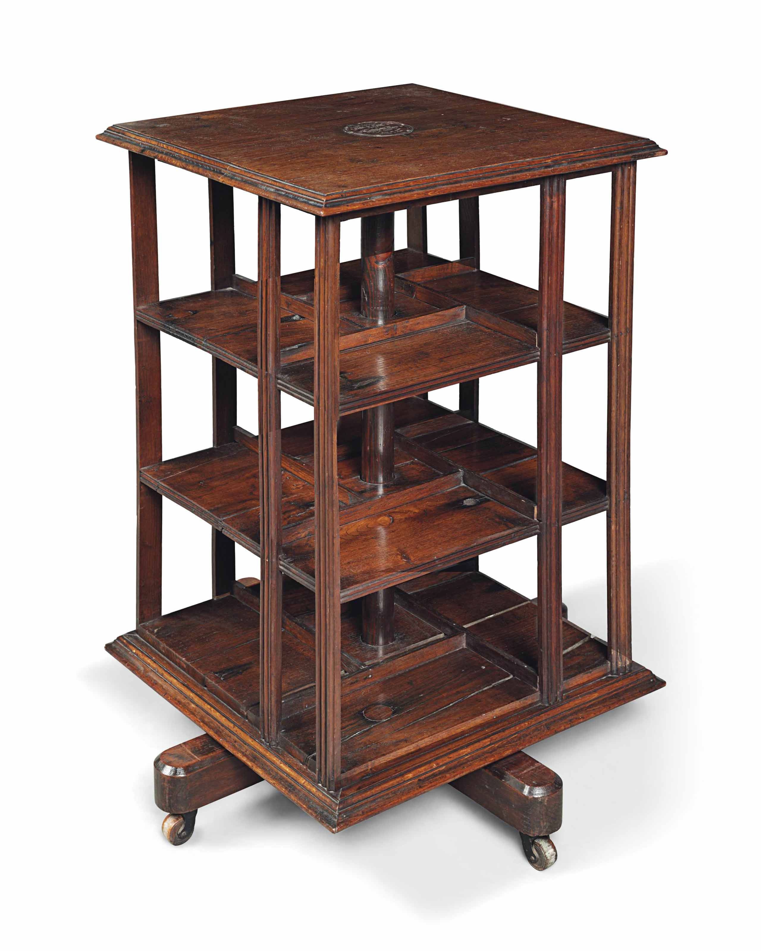 A REVOLVING BOOKCASE MADE OF TIMBERS RECOVERED FROM ADMIRAL LORD NELSON'S FLAGSHIP, THE FOUDROYANT