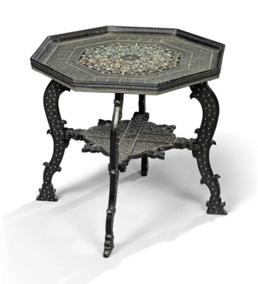 A NORTH INDIAN CARVED EBONY AN
