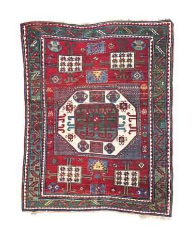 An antique Kazak Karatchopf ru