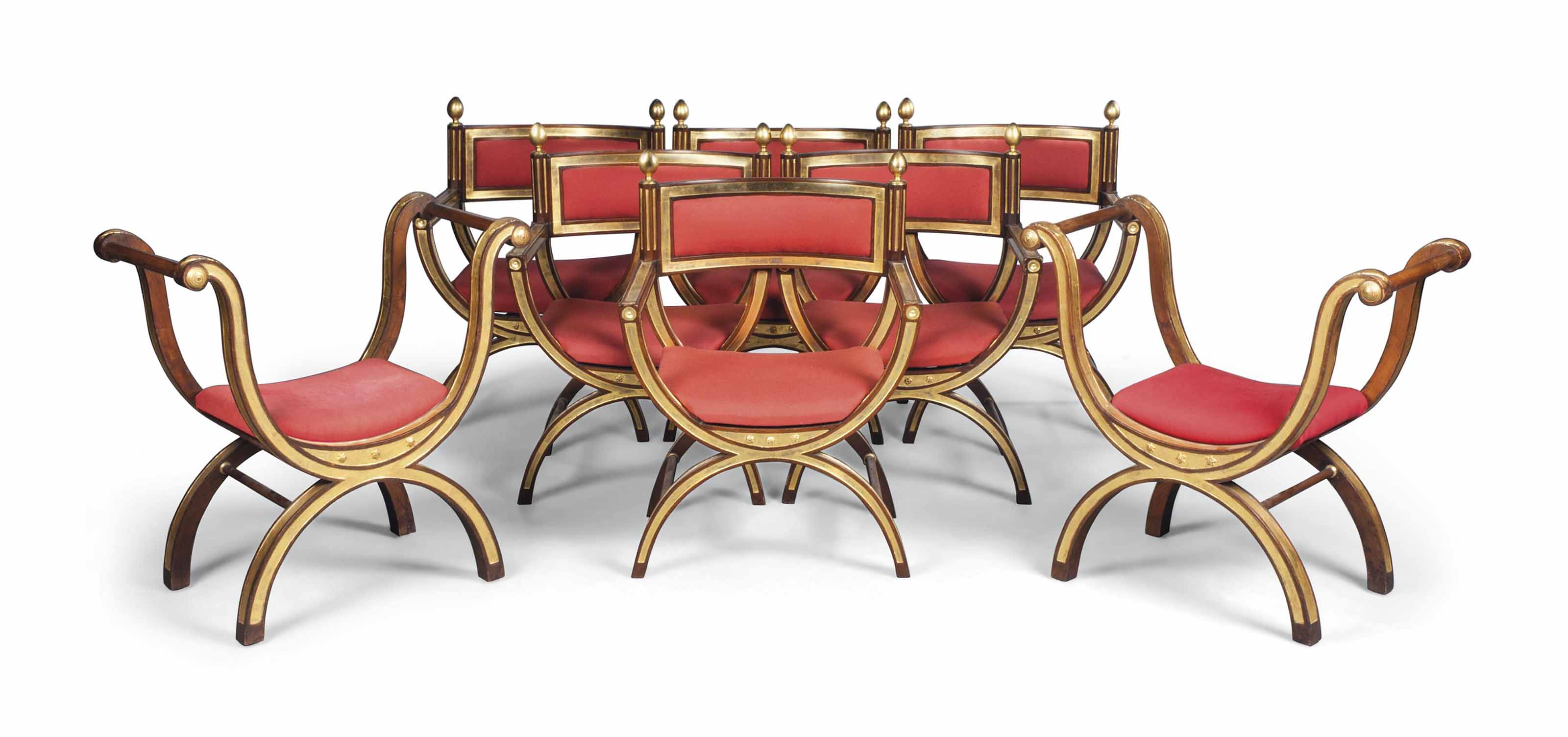 A SET OF SIX ENGLISH MAHOGANY AND PARCEL-GILT 'CURULE' OPEN ARMCHAIRS