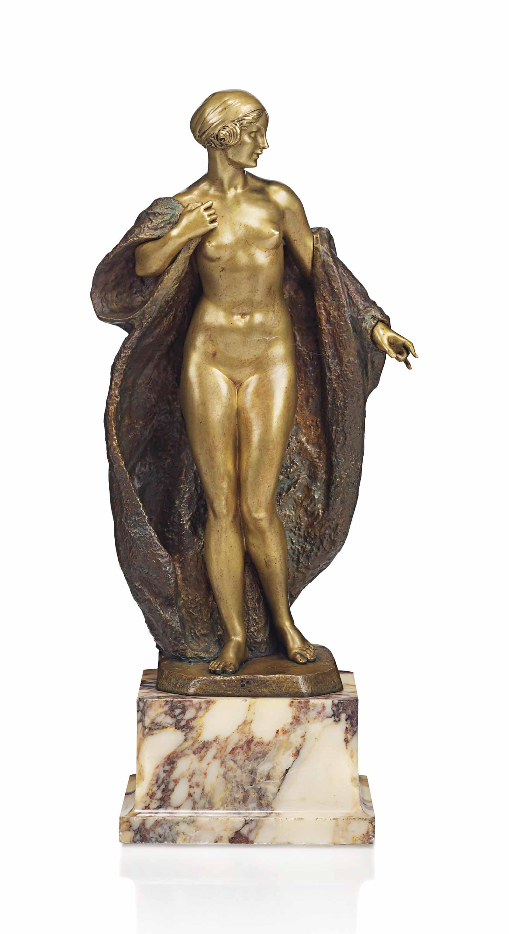 A JOE DESCOMPS (CORMIER) (1869-1950) PATINATED AND GILT BRONZE FIGURE