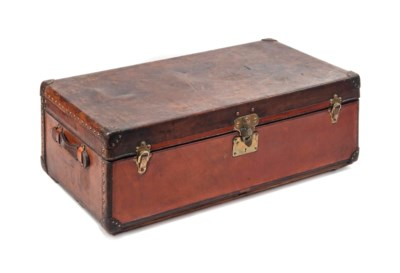 A TRUNK IN NATURAL COW HIDE