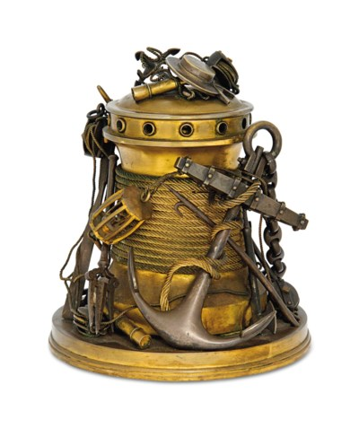 A NOVELTY BRASS TOBACCO JAR