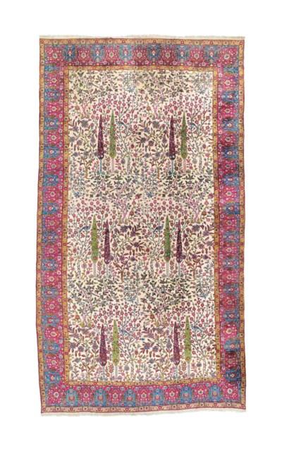 A large fine Teheran carpet
