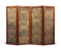 A LATE VICTORIAN OAK FOUR-FOLD SCREEN