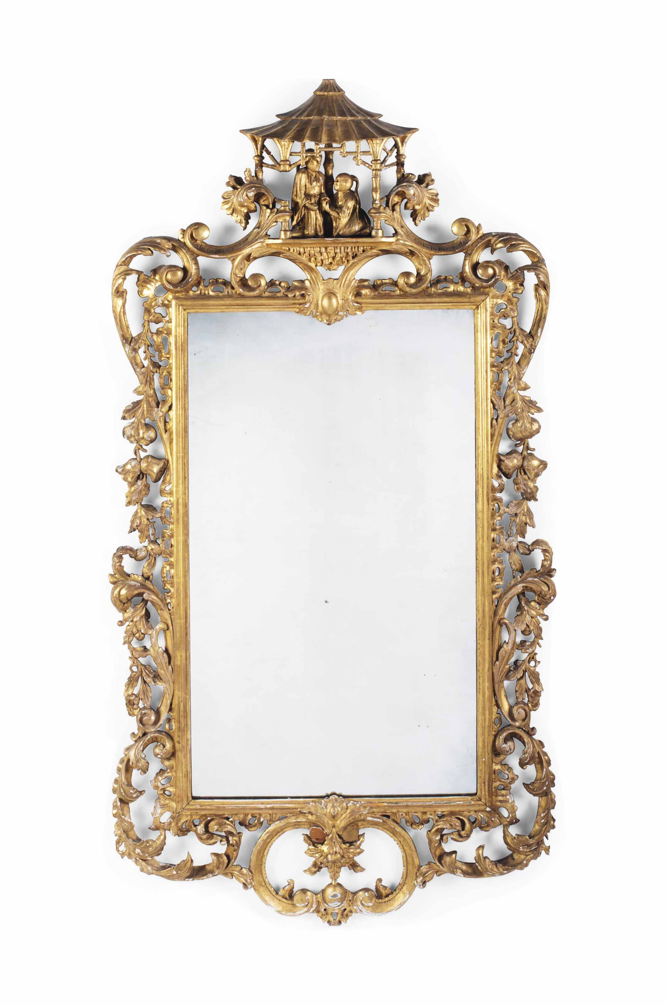 A VICTORIAN CARVED GILTWOOD MIRROR