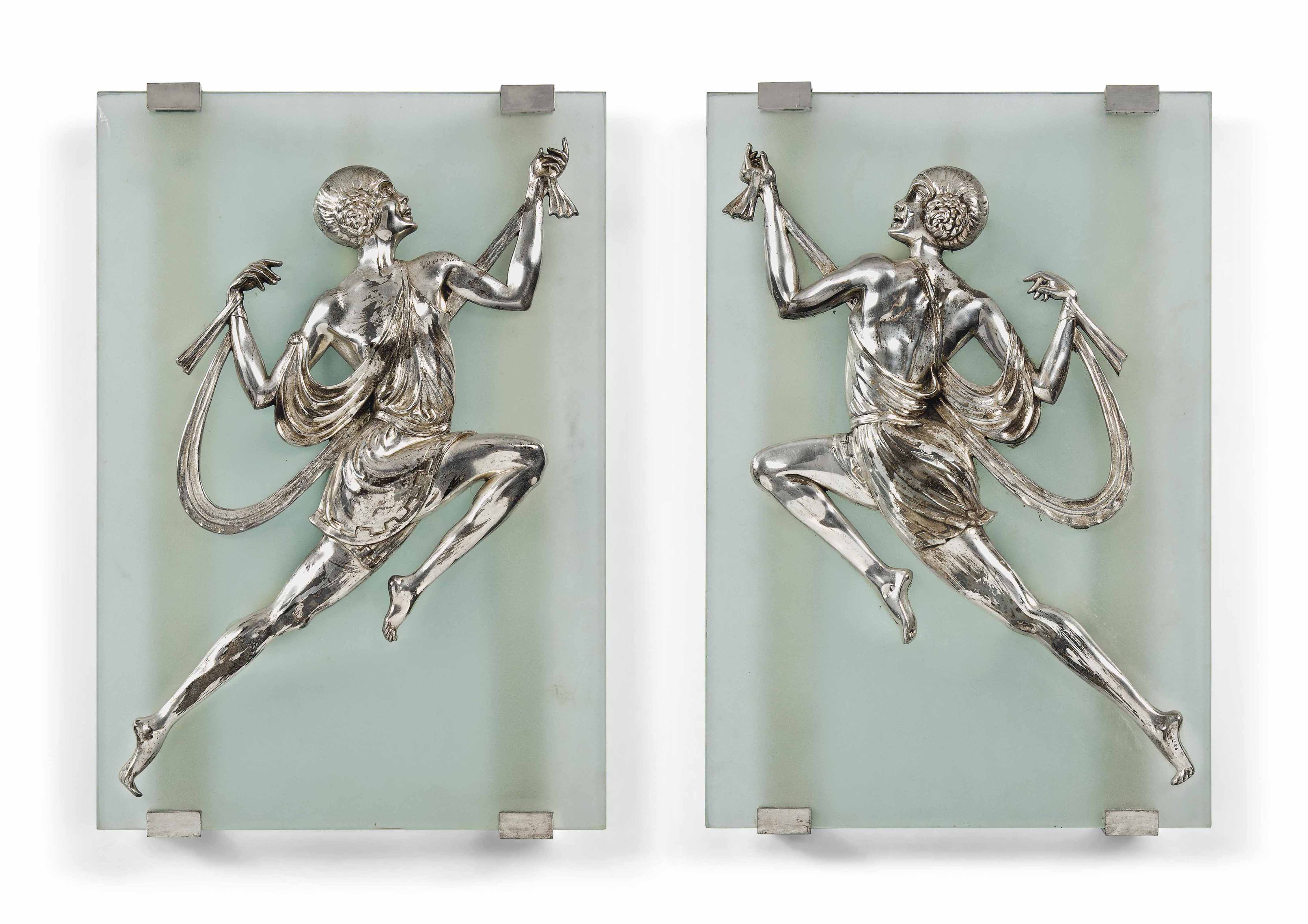 A pair of art deco silvered metal and glass wall lights in for Objet metal deco