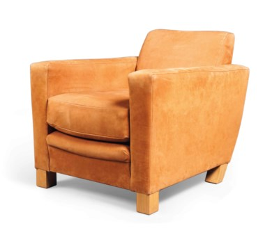 AN OAK AND SUEDE EASY ARMCHAIR